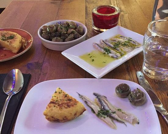 Spinach omelette, garlic mushrooms and vinegar marinated achovies
