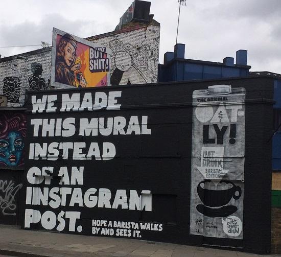Oatly oat milk advertising hoarding in london