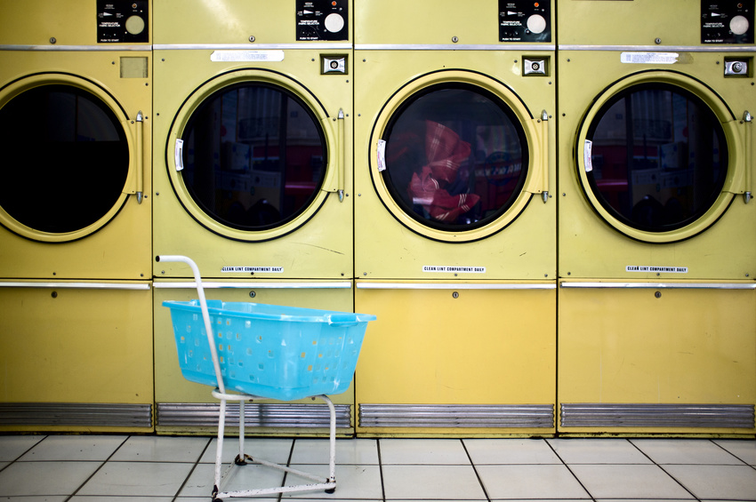 yellow laundry machines in laundrette
